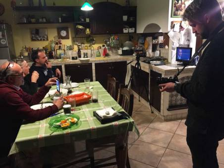 Nick filming Lorenzo and parents in their kitchen.