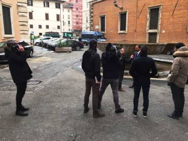 Lorenzo giving an interview in the streets of Rome. On the left, Nick filming Lorenzo being flimed.