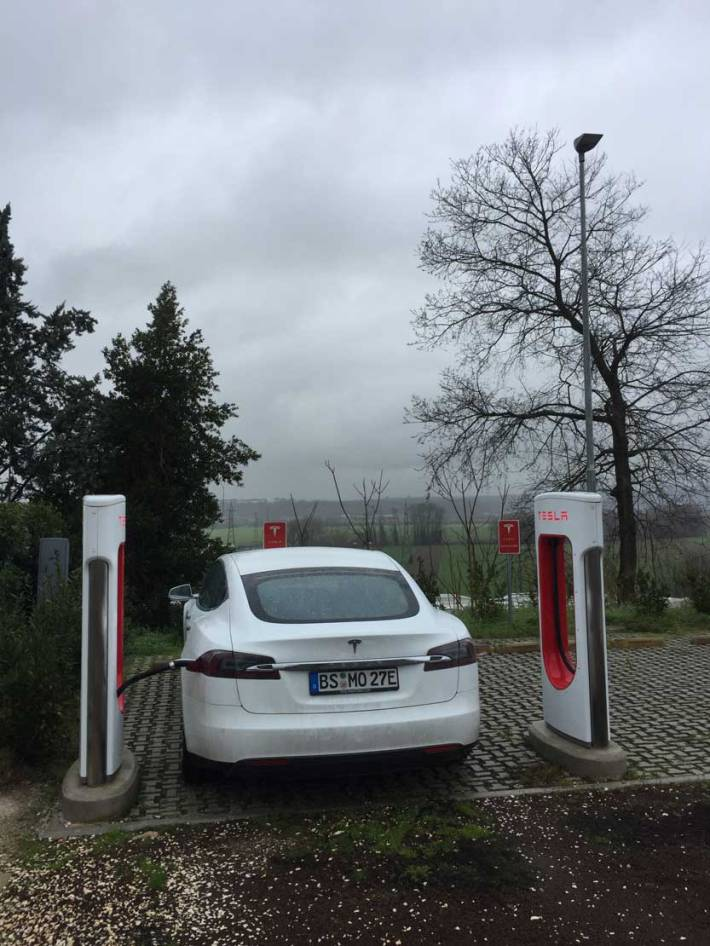 Charging the car on the way back.